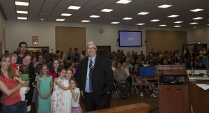 Superintendent Jack Smith with a roomful of winners and their parents.